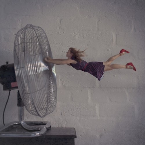 holding on, being swept away, windy fan