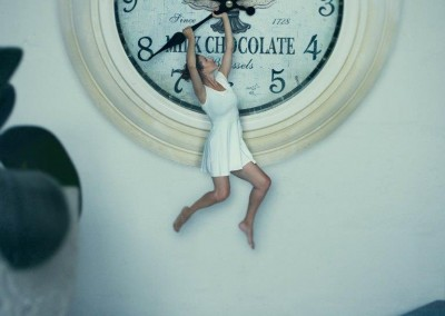hanging from a clock for personal fine art photo project by Abigail K Photography