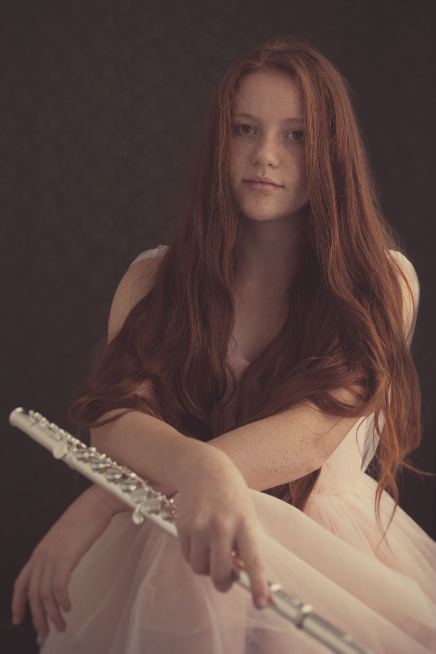 Whimsical girl with flute