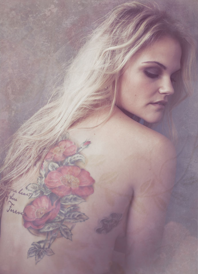 blonde girl with back tattoo portrait photography