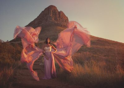 Fine art photography epic dress by Cape Town photographer Abigail k. In front of Lions Head.