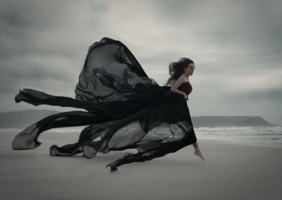 Women's Fine Art Photography Cape Town - women in black dress on Noordhoek Beach
